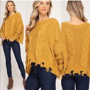 Sweaters - Mustard cable knit frayed hem sweater.